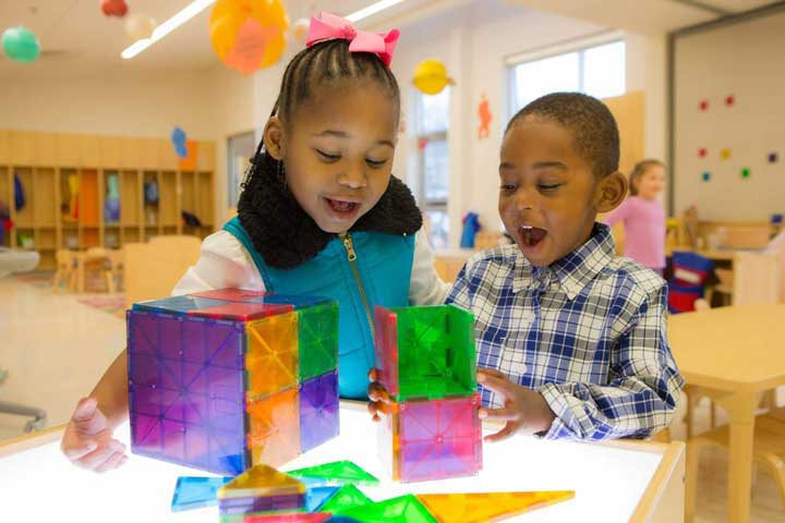 children play with colorful shapes