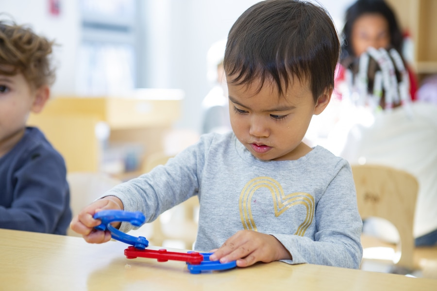 child concentrating while playing